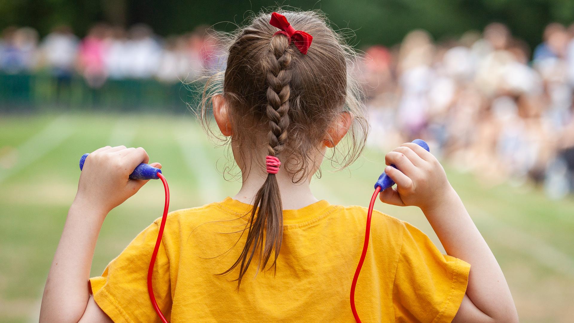 Child taking part in school sports day.