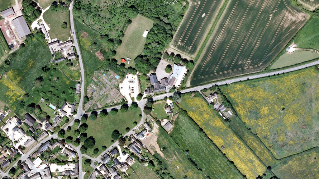 Kingham Primary School. Located in the centre of this aerial image, showing the village green of Kingham, Oxfordshire, in England.