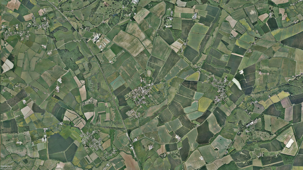 Kingham Primary School. Located in the centre of this aerial image of West Oxfordshire in England.